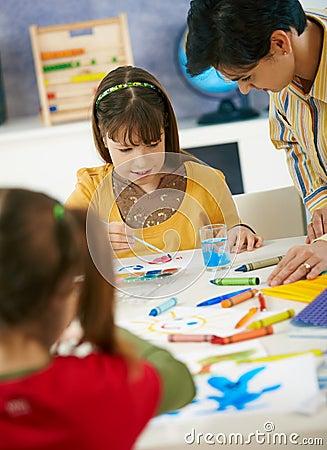 Elementary age schoolgirls painting