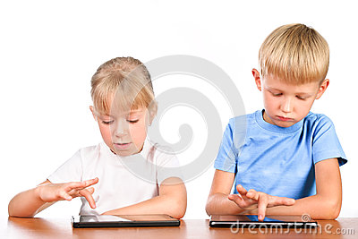 Elementary boy and girl using digital pads