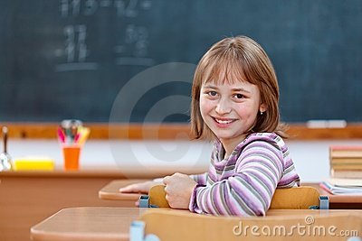Elementary school girl turning back and smiling