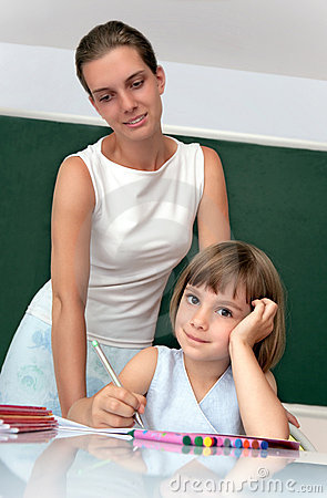 Elementary school pupil working with a teacher