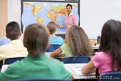 Elementary school teacher in geography class