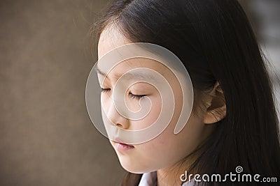 Elementary schoolgirl praying