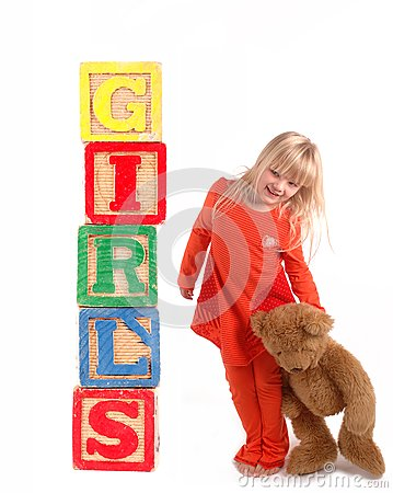 Elementary student with wooden blocks