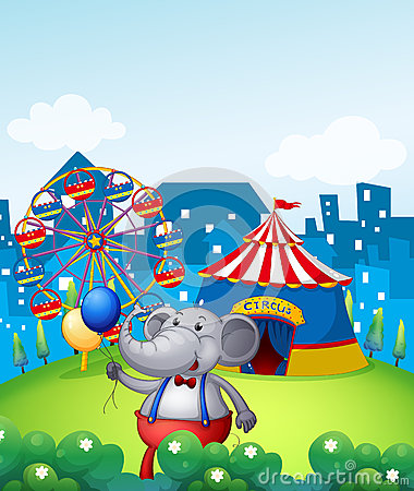 An elephant with balloons in front of a carnival