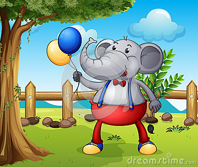 An elephant holding balloons