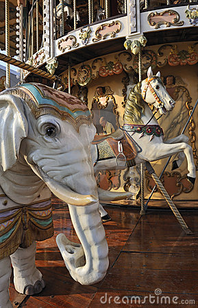 Elephant and horse on fairground carousel