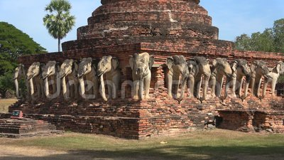 Elephant sculptures at the base of the Chedi ancient Buddhist temple Wat Sorasak. Sukhothai, Thailand. Elephant sculptures at the base of the Chedi ancient stock footage