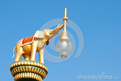 Elephant statue holding a lamp