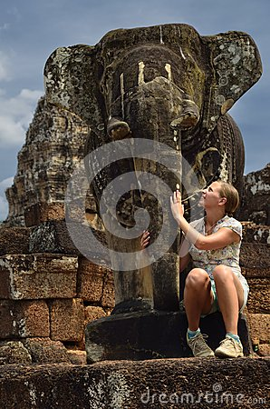Elephant statue is pampered by girl