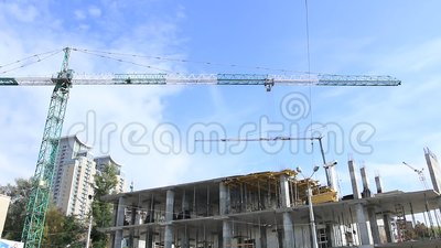 Elevating construction crane against blue sky stock footage