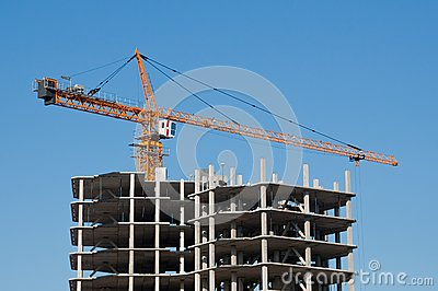 The elevating crane on clear blue sky background