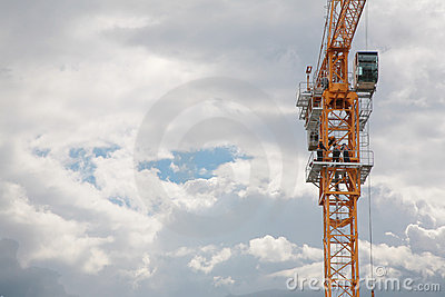 Elevating crane and sky with clouds