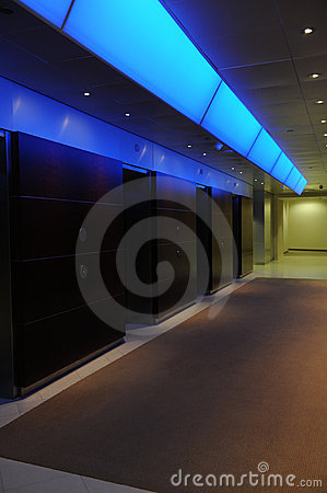 Elevators in office building with blue light accen