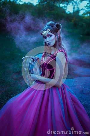 Free Elf Woman In Violet Dress Royalty Free Stock Photos - 106085748