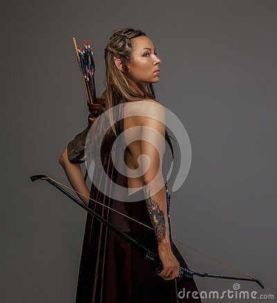 Free Elf Woman With A Bow. Stock Image - 112964771