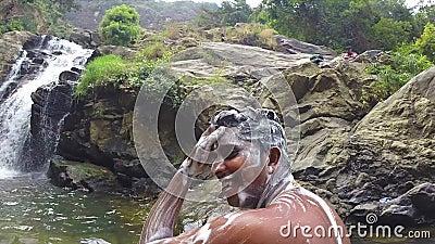 ELLA, SRI LANKA - MARCH 2014: Men Washing With Soap In