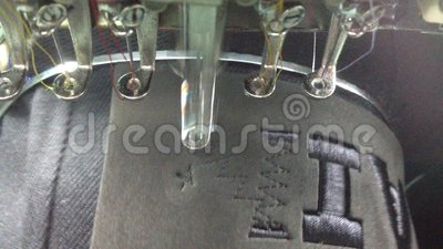 Embroidery Work. Embroidery machine sewing a hat stock video