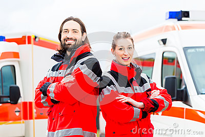 Emergency doctor and paramedic with ambulance