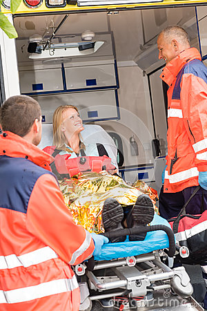 Emergency doctor with woman in ambulance