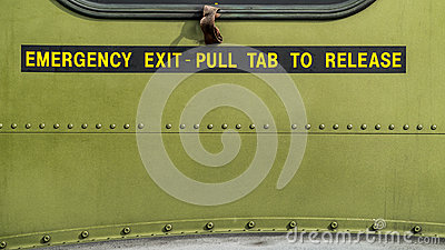 Emergency Exit - Pull tab to release