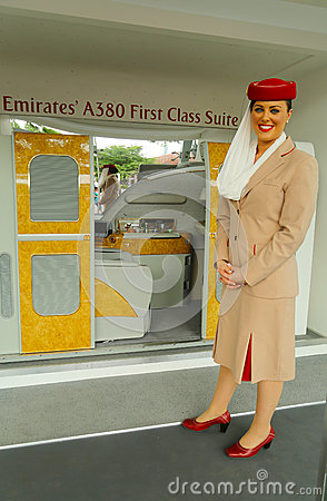Emirates Airline flight attendant at the Emirates Airline booth at the Billie Jean King National Tennis Center during US Open 2013 Editorial Photo