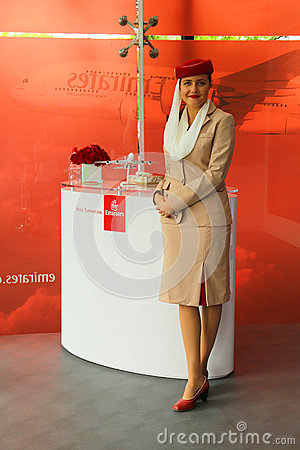 Emirates Airline flight attendant at the Emirates Airline booth at the Billie Jean King National Tennis Center during US Open 2013 Editorial Stock Photo