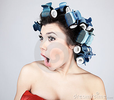 Emotional Girl with hair-curlers on her head