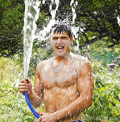 The emotional guy the brunette with water splashes