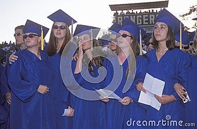 Emotional high school graduates Editorial Image