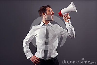 Emotional man in formal wear using megaphone