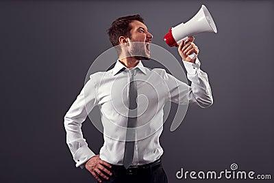 Emotional man in formal wear using megaphone