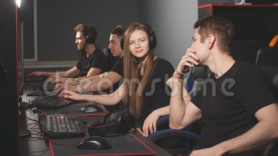 Emotional scene in pc gaming club where one gamer succeed, another lost battle. Win some, lose some. Emotional scene in pc gaming club where one gamer succeed stock footage