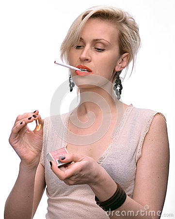 Emotional sexy woman posing with cigarette and matches