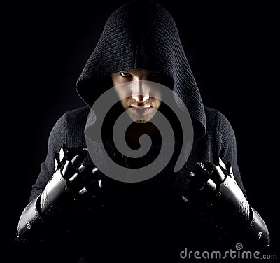 Free Emotional, Young And Attractive Assassin In Gloves On The Black Background. Stock Images - 88048434