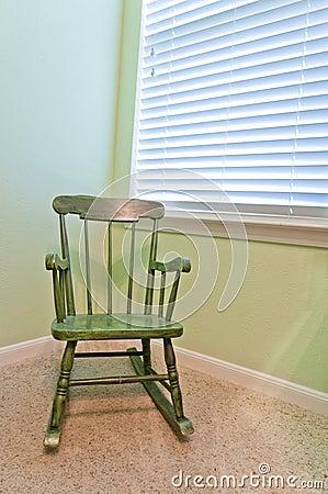 Empty Antique Child s Rocking Chair