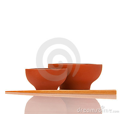 Empty asian ceramics bowls and wood chopsticks