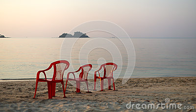 Empty beach three chair