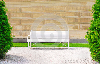 Empty bench on the wall background a sunny day