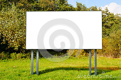 Empty billboard standing in a field