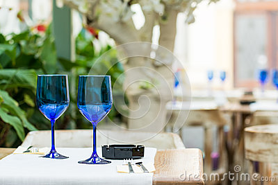 Empty Blue Glasses On Restaurant Table