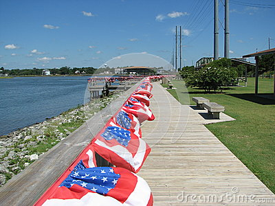 Empty boardwalk with Fourth of July flags
