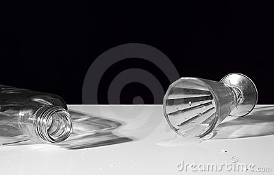 Empty bottle and overturning liquor-glass