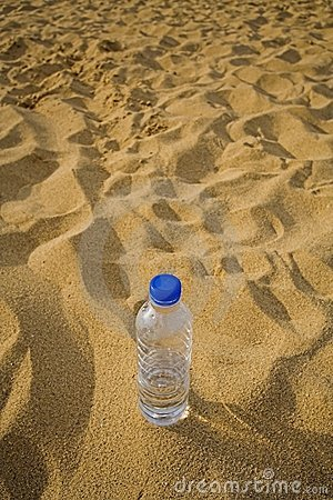 Empty Bottle In Sand Royalty Free Stock Photos - Image: 845718