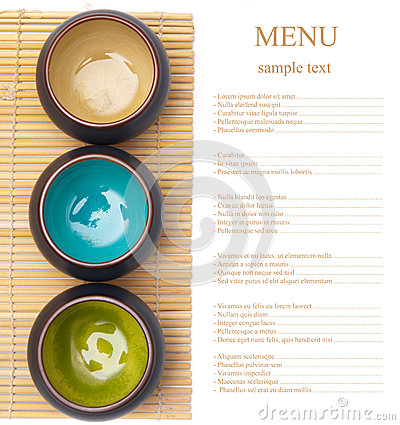Empty ceramic bowls on bamboo placemat