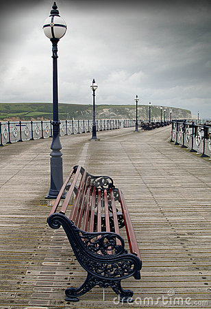 Empty chair lonely rainy pier