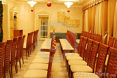 Empty chairs in rows at presentation in hotel