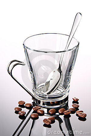 Empty coffee cup with coffee beans and spoon