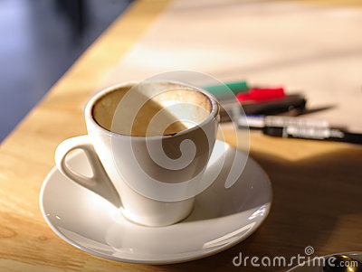 Empty coffee cup with working background