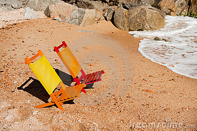 Empty colorful chairs at the beach