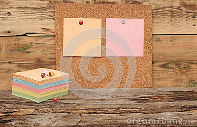 Empty cork board with colorful stack note papers